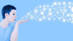 pixabay-woman-blowing-snowflakes